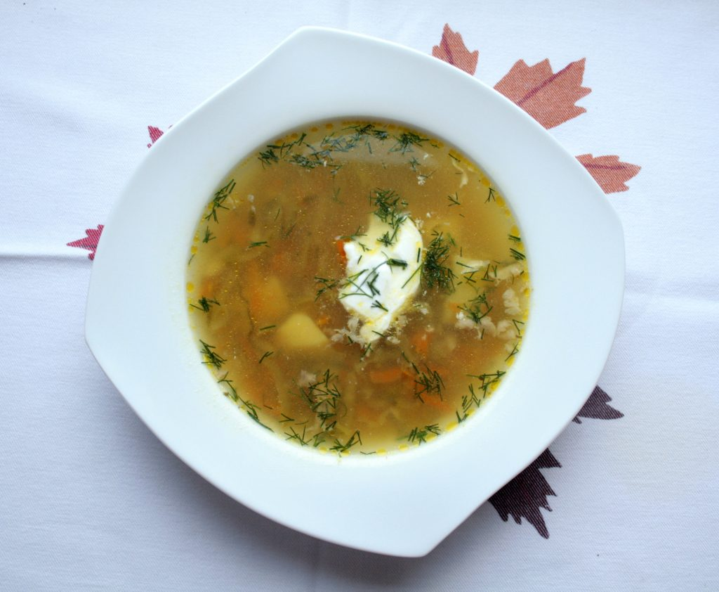 Polish cucumber low FODMAP soup, served with lactose free sour cream and fresh dill.
