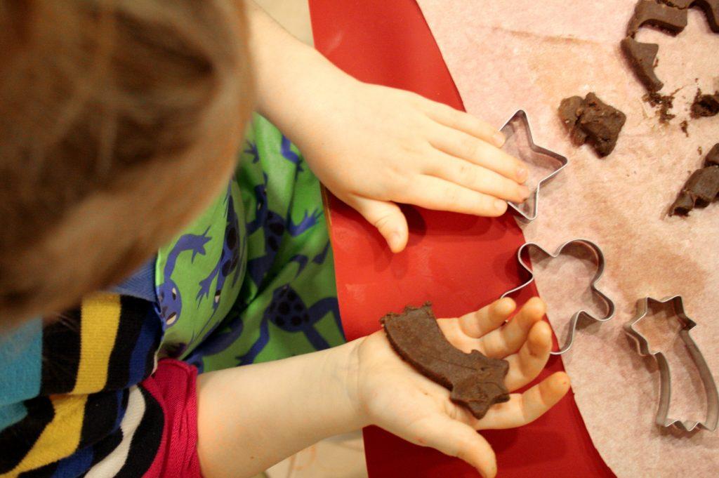 child making gf gingerbread man