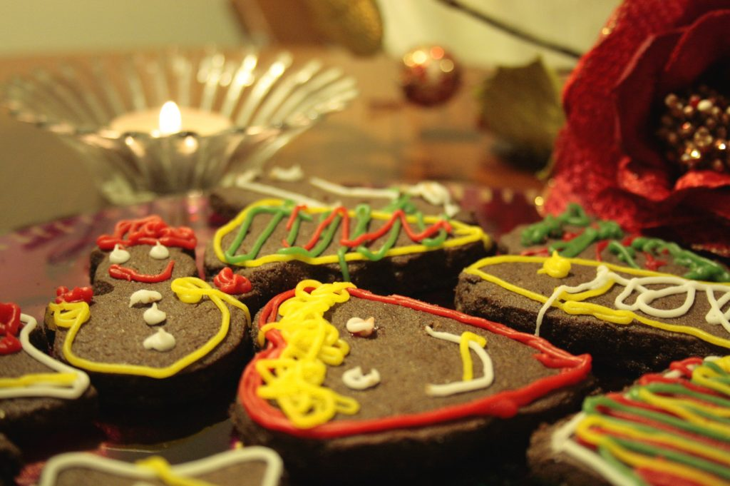decorated gingerbread biscuits and a candle light