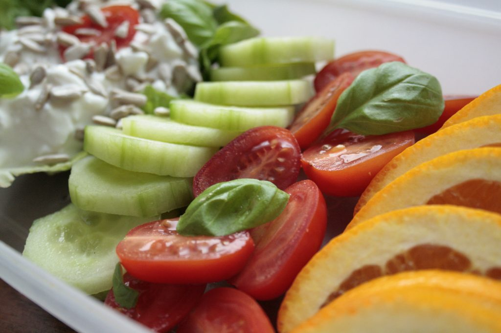 Low FODMAP snack with fruit, vegetables, seeds and cheese