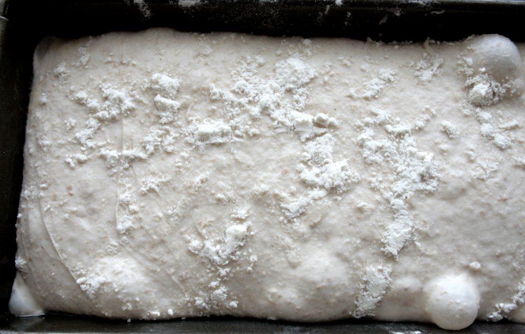 sourdough bread in a tin before baking