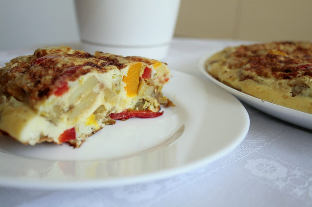 A slice of a Low FODMAP Spanish Omelette