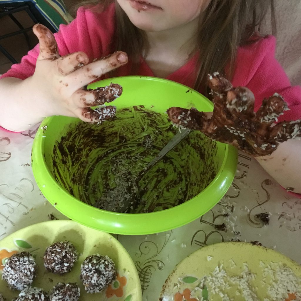 A child that enjoyed making the Oat Chocolate Balls