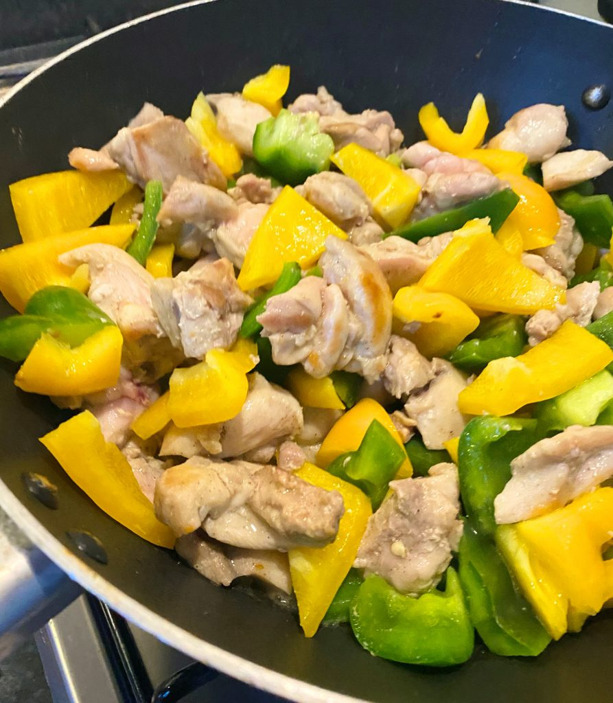 Diet Cola chicken cooking with peppers